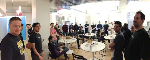 Engineers gather to kick off the hackathon in Magnetic's kitchen